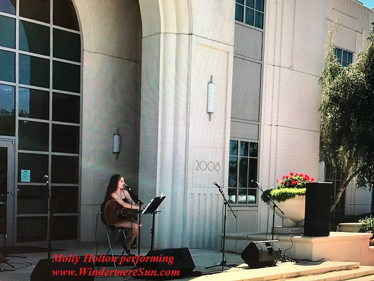 Molly Holton in front of the Winter Garden City Hall final