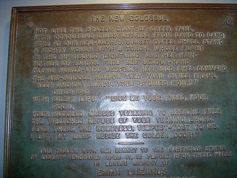 Plaque of The New Colossus poem by Emma Lazarus -Mother of Exiles in the museum inside the pedestal of the Statue of Liberty. Plaque was erected in 1903, photo attrib-melanzane final