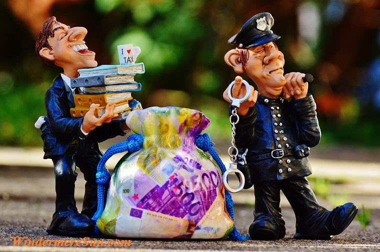 taxes-tax-evasion-police-handcuffs final