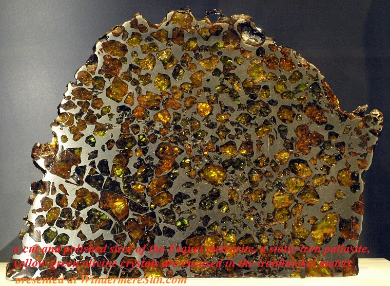 Pallasite-Esquel-RoyalOntarioMuseum-Jan18-09, A cut and polished slice of the Esquel meteorite, a stony-iron pallasite. Yellow-green olivine crystals are encased in the iron-nickel matrix final.