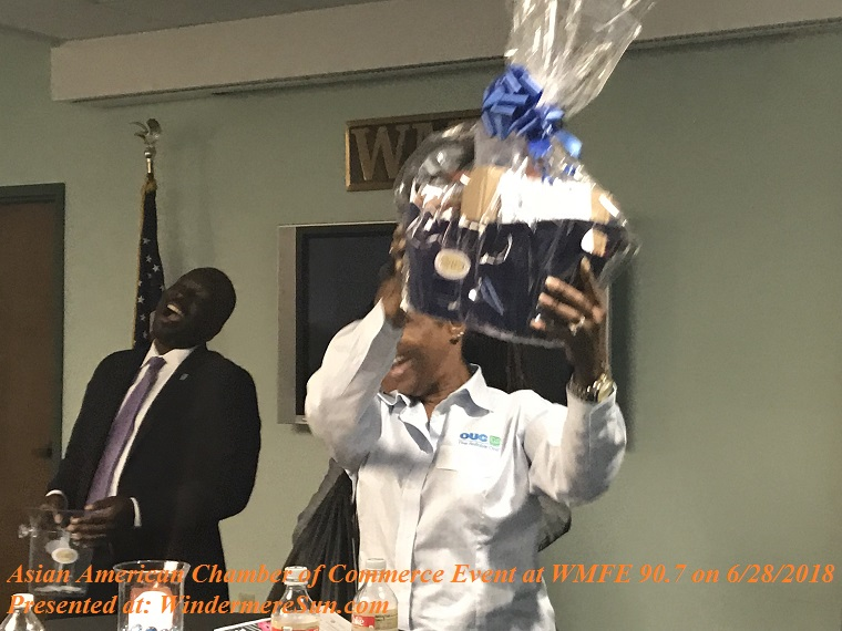 Happy recient of the door prize, OUC representative final