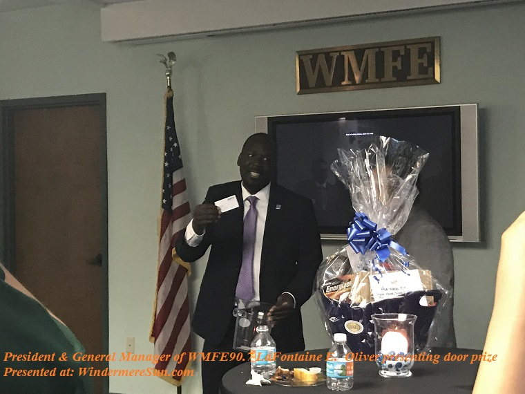 President and General Manager of WMFE90.7 LaFontaine E. Oliver presenting door prize final