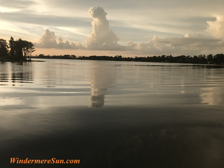 peaceful water and towering cloud final