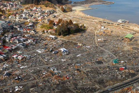 japan-tsunami-damage  an aerial view of damage to Sukuiso, Japan, a week after the earthquake and subsequent tsunami devastated the area in March, 2011.