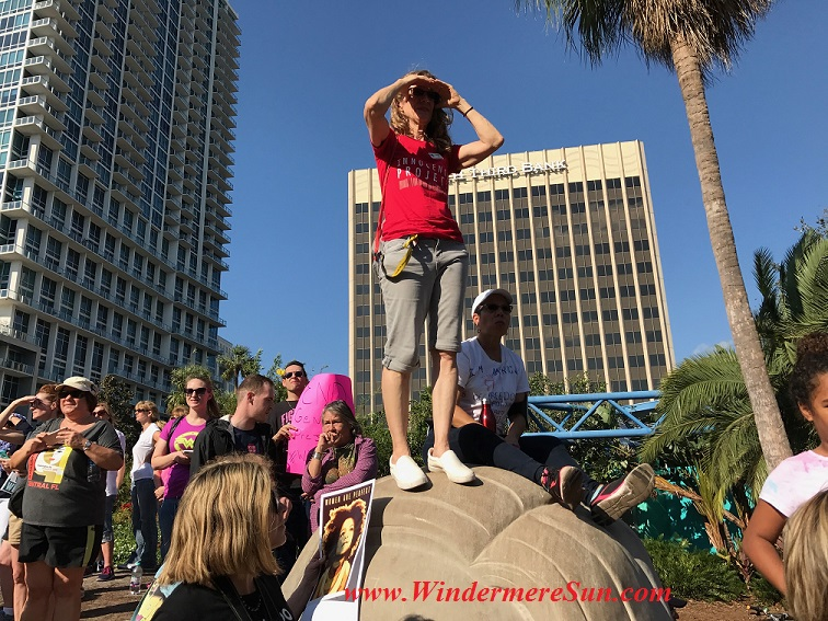 Woman on top of a rock or concrete palm final