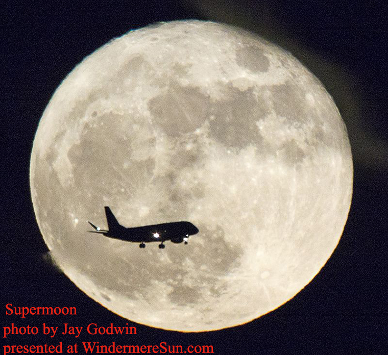 An airplane on approach to the airport flies past a full 'supermoon' rising over the LBJ Presidential Library on November 14, 2016, in Austin, Texas, by Jay Godwin final