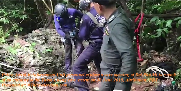 Tham Luang cave rescue-Police_exploring_cave_opening_at_Doi_Pha_Mi final