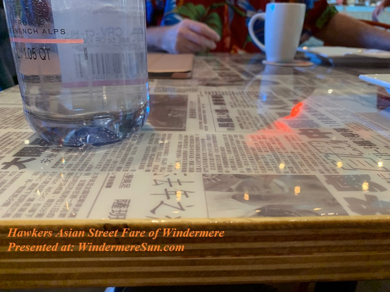 Hawkers' newspaper covered table top, viewed from side final