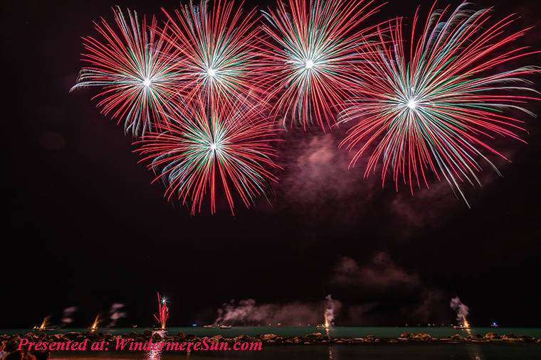 fireworks, red-fireworks-near-body-of-water-1573715 final