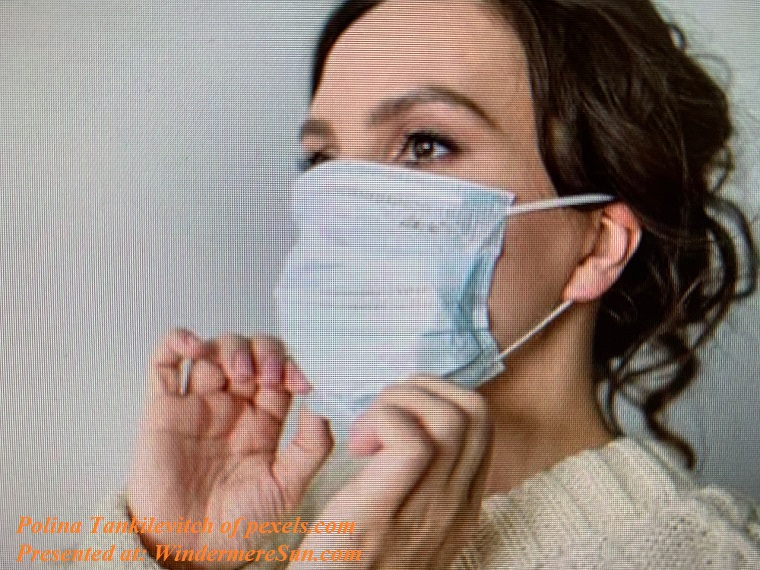 Woman wearing and handling mask final